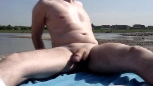 Me in total jerking off at public river