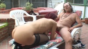 Mature couple poolside