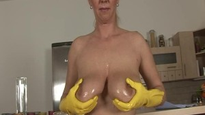 busty MILF playing wild in her kitchen