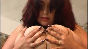 Brunette MILF shakes and teases with her jumbo boobs