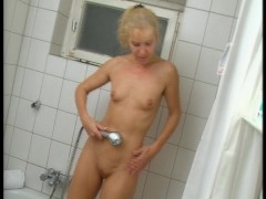 Picture Blonde stops getting dressed to play with he...