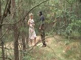 Blonde blows guy in the camouflage of the jungle