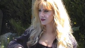 Girl in black fingers herself while being interviewed