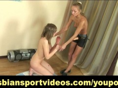 Sensual lesbian strap-on during naked workout
