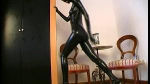 Pornstar strips in black shiny latex