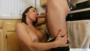 Busty housewife fucks in the kitchen