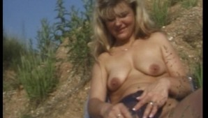 Older broad doing herself  in the weeds (clip)