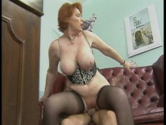 Redhead  with big tits takes on two at a time