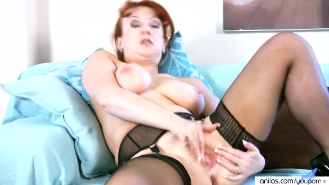 Redhead busty milf in stockings masturbates