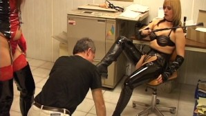 Fem doms in leather force guy to lick boots and butts