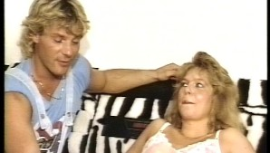 Blonde haired couple fuck on a bed