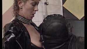 Biker couple enjoys leather costumes and fucking in the bathroom.