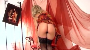 Blonde masturbates in panties and sheer stockings