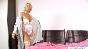 Cock hungry granny masturbates on bed with her dildo