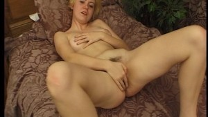 Blonde strips down and gets herself off in bed