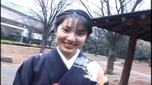 Cutie in kimono gives double blowjob outside