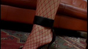 Mature babe in red fishnets takes two dicks