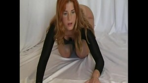 Flexible Redhead in nylon dress (clip)