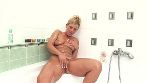 Blonde MILF Janet showering off