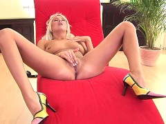 Pretty blonde Oxana plays with a dildo