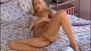 Pretty blonde Julia with a dildo