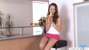 Tiny teen fucks a banana