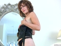 - Milf rubs her pussy to...