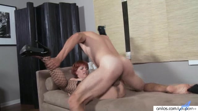 Frisky mature redhead in fishnets