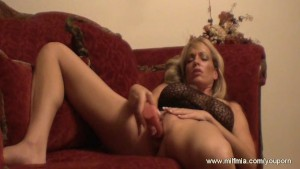 Babe Jerking Off on Red Couch