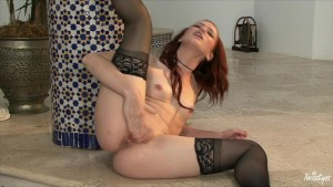 Sexy young brunette in lingerie finger-fucks her w