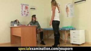 Army doctor gives special examination to busty blonde girl