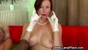 Mature ladies take turns with a strapon