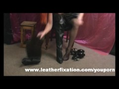 Dirty redhead put on leather skirt and boots and rubs her wet pussy