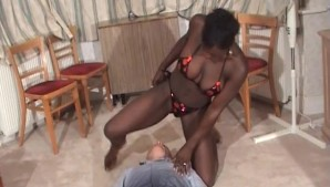 Black lady in bikini dominates an old man
