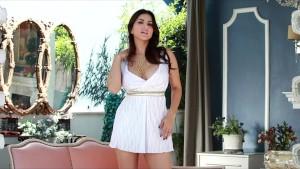 Beautiful brunette Sunny Leon strips off her sun dress
