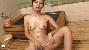 Gorgeous Japanese Cougar Nana Nanami soaps up her sexy body