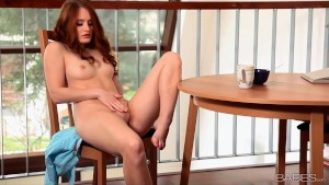 Beautiful redhead with sexy long legs masturbates