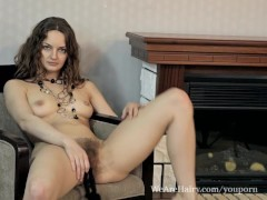 Picture Hairy Ginger makes it hot by the fireplace