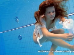 Picture Cute Zuzanna is swimming nude in the pool