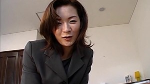 Gorgeous Japanese MiLF in an office suit sucks a big cock before climbing aboard