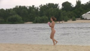 Young nudist friends naked together at the beachclick to edit