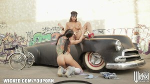 Pair of tattooed chicks eat each otther out on the hood of a car