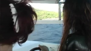 Sexy girl in a shiny dress on a boat - Absurdum Productions