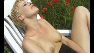 Sexy blonde plays with her rosebud in a flower field- Pleasure Photorama