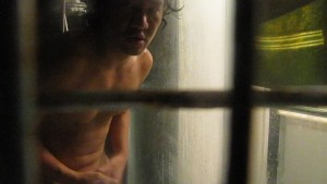 HUNK WITH A BIG COCK BEHIND BARS IN THE SHOWER