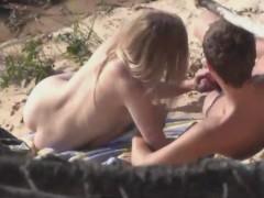 Horny couple spied on the beach