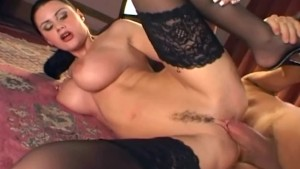 Glamour babe fucking in black stockings and heels