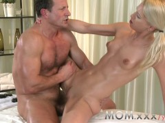 MOM Blonde MILF Gives her man a rub and tug