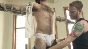 Hung boytoy is tied up and teased