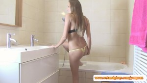 Cute blonde teen pees in the bath tub